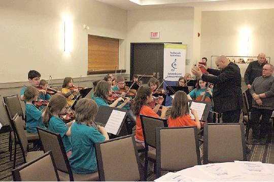 Sistema NB Richibucto Centre Director--Swan Serna guest conducts the Sistema Miramichi Children's Orchestra