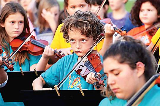 Paydon Corbin, 10, plays his viola at the Sistema Miramichi performance in the summer of 2018. PHOTO: SUBMITTED