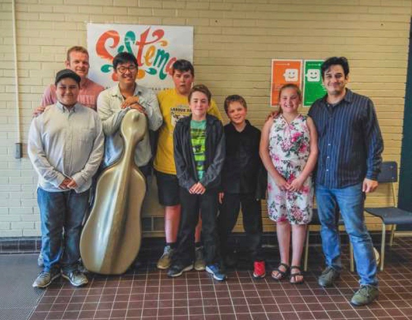 Five musicians from the Sistema NB Tobique Centre recently travelled to Moncton to audition for the NBYO. From left are Koda Wolfe, Centre Director Dave Halpine, Teaching Artist Jaeyoung Chong, Darian Bear, Aaron Halpine, Jacob Halpine, Hilary Bailey an Maestro Tony Delgado--Music Director & Conductor of the NBYO.